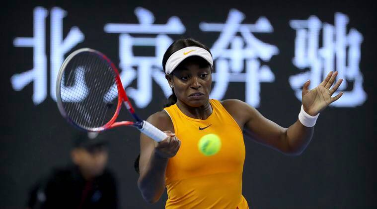Sloane Stephens of the United States plays a return shot while competing against Dominika Cibulkova of Slovakia in their third round women's singles match in the China Open at the National Tennis Stadium in Beijing