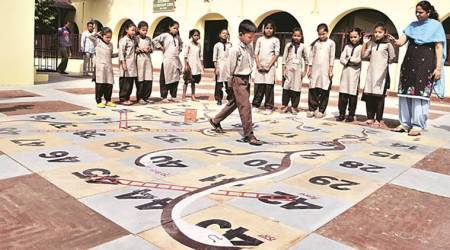 At colonial-era school in Amritsar, conservation experts create Indian 'snakes andladders'