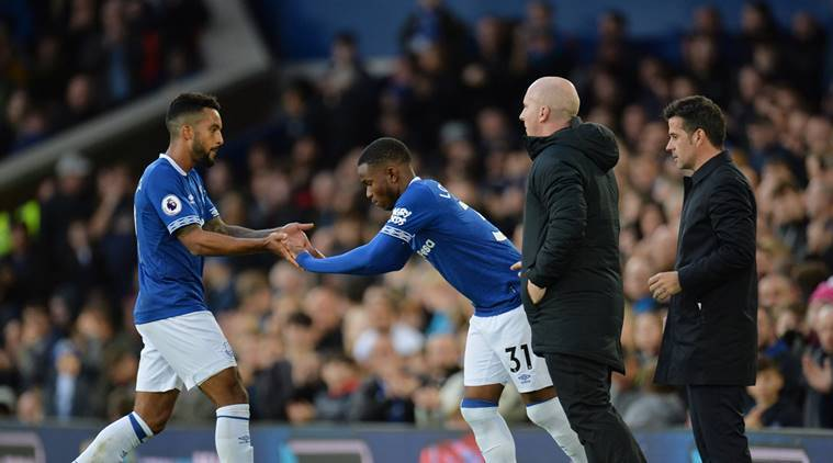 Everton's Ademola Lookman comes on as a substitute to replace Theo Walcott as manager Marco Silva looks on