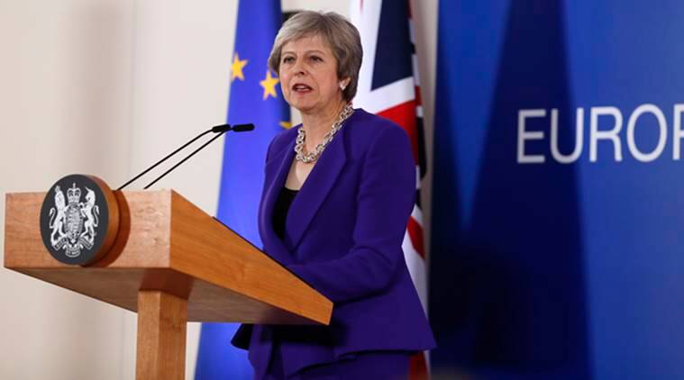 UK's Theresa May says Brexit transition period could grow, draws ire