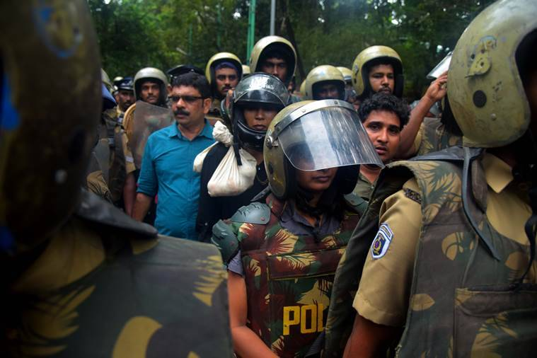 Hyderabad-based jounalist Kavitha Jakkal and activist Rehna Fathima accompanied by police personnel on Friday