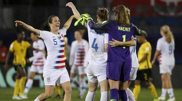 United States defender Kelley O'Hara celebrates with teammates after defending Jamaica 6-0 following a soccer match at the CONCACAF women's World Cup qualifying tournament in Frisco, Texas