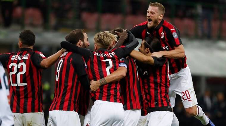 AC Milan players celebrate after Alessio romagnoli scored his side' second goal during the Serie A soccer match between AC Milan and Genoa at the San Siro Stadium in Milan, Italy