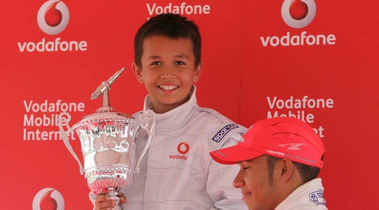 McLaren's Lewis Hamilton presents the winners trophy to Alexander Albon