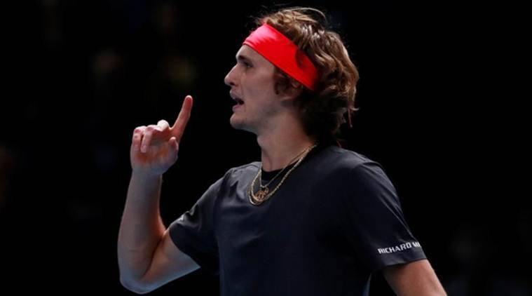 Alexander Zverev celebrates after winning the first set during his group stage match against Marin Cilic.