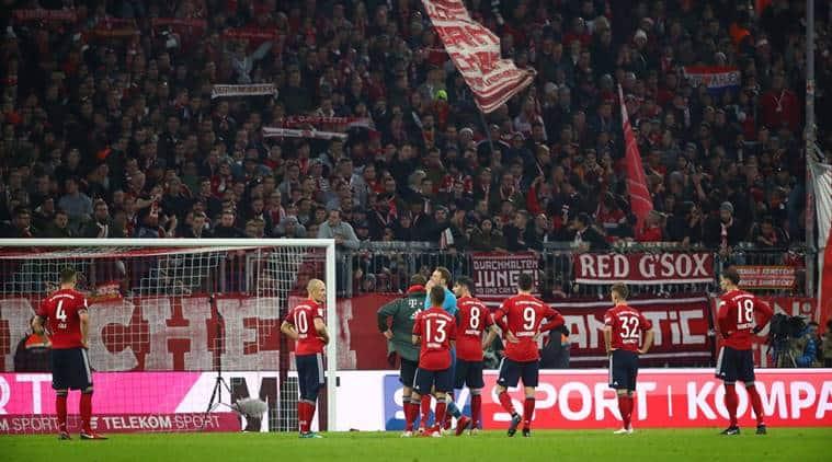 Bayern Munich's Robert Lewandowski, Arjen Robben and team mates look dejected at the end of the match against Fortuna Dusseldorf