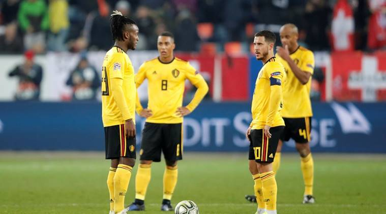 Belgium's Eden Hazard, Dedryck Boyata and team mates look dejected after conceding their fifth goal scored by Switzerland's Haris Seferovic (not pictured) in the UEFA Nations League