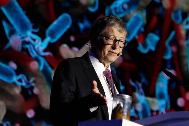 Bill Gates gives a speech with a jar of faeces next to him on the future of toilets