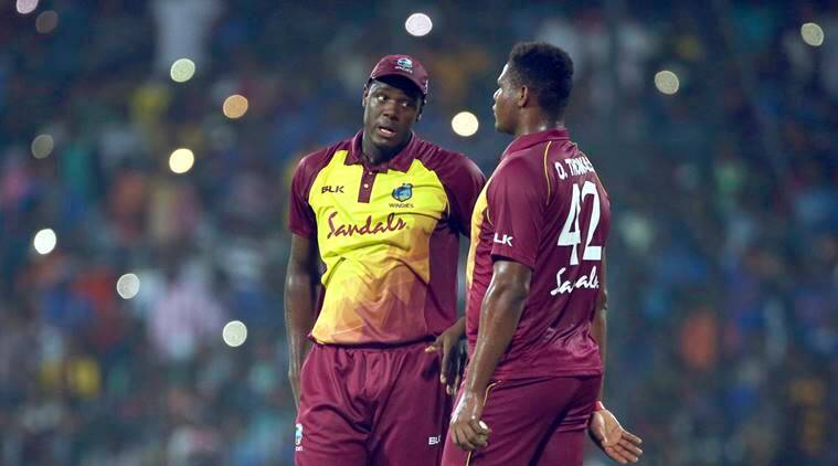 West Indies' Oshane Thomas, right, listens to captain Carlos Brathwaite before bowling his next delivery during the third and last Twenty20 international cricket match between India and West Indies in Chennai