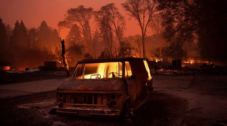 California wildfire leaves town in ruins, thousands flee