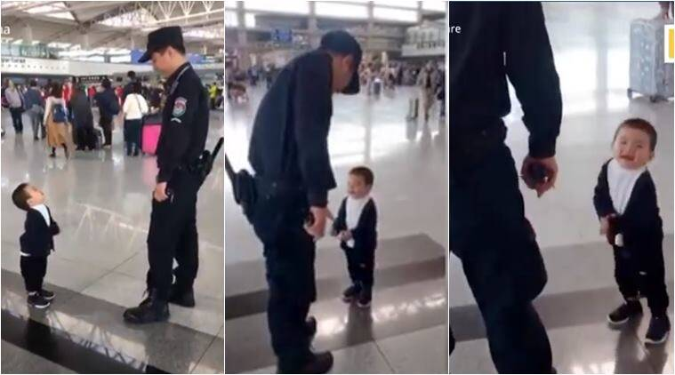 children video, cute baby videos, boy mesmerised by security guard, boy wants hug from security guard, china videos, cute videos, viral videos, indian express