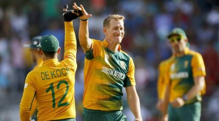 Chris Morris celebrates with De Kock