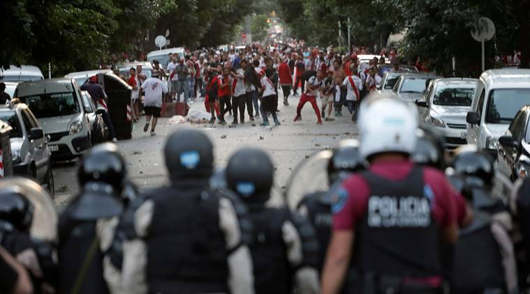 River Plate's fans clash with riot police after the Copa Libertadores Final, Second leg v Boca Juniors match was postponed.