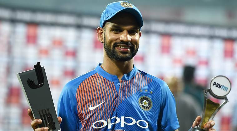 Shikhar Dhawan poses with the Man of the Match trophy