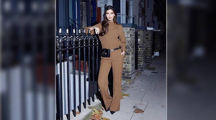 Diana Penty looks chic in this plain brown jumpsuit from Zara