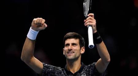 Serbia's Novak Djokovic celebrates winning his group stage match against John Isner of the U.S.