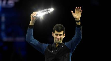 Second placed Serbia's Novak Djokovic celebrates with a trophy after losing the final against Germany's Alexander Zverev