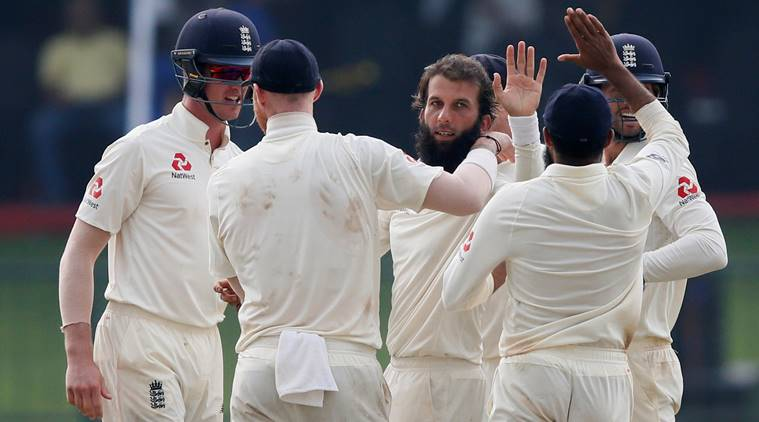 Moeen Ali celebrates with his teammates