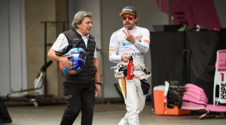McLaren's Spanish driver Fernando Alonso walks in the pits