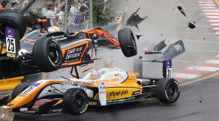 Teenage driver Sophia Floersch of Germany, top, goes over Japanese driver Sho Tsuboi's car while flying off the track at high speed on a tight right-hand bend on lap four at the Macau grand Prix