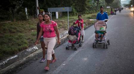 The Espinar family walks on the road that connects Pijijiapan with Arriaga, Mexico.