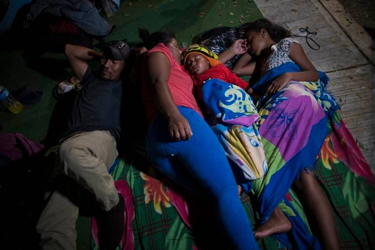 The Espinar family sleeps on the floor after arriving in Arriaga