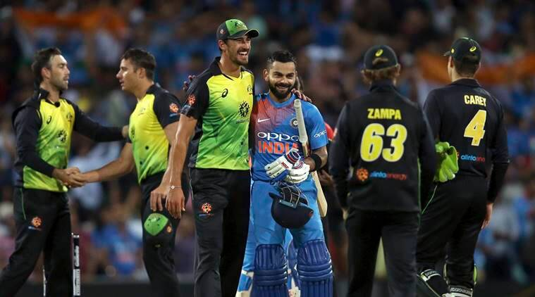 India's Virat Kohli is embraced by Australia's Mitchell Starc after their Twenty20 cricket match in Sydney