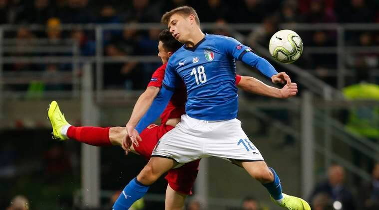 Portugal's Mario Rui, left, and Italy's Nicolo Barella jump for the ball during the UEFA Nations League soccer match between Italy and Portugal at the San Siro Stadium, in Milan