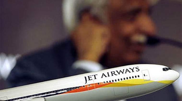 A model of a Jet Airways aircraft with chairman Naresh Goyal in background.