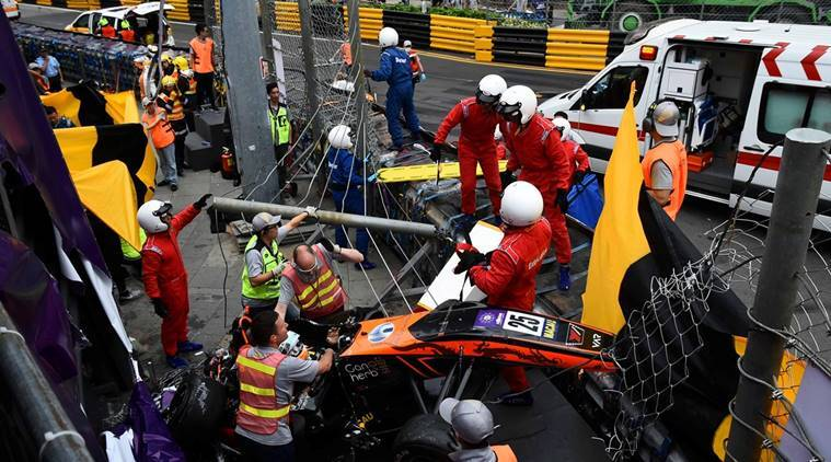 Race personnel and pit crew are seen at the accident site after Sophia Floersch, a German driver of Van Amersfoort Racing flew over the barriers and crashed into a photographers' bunker at high speed, during a Formula Three race at the Macau Grand Prix, in Macau, China
