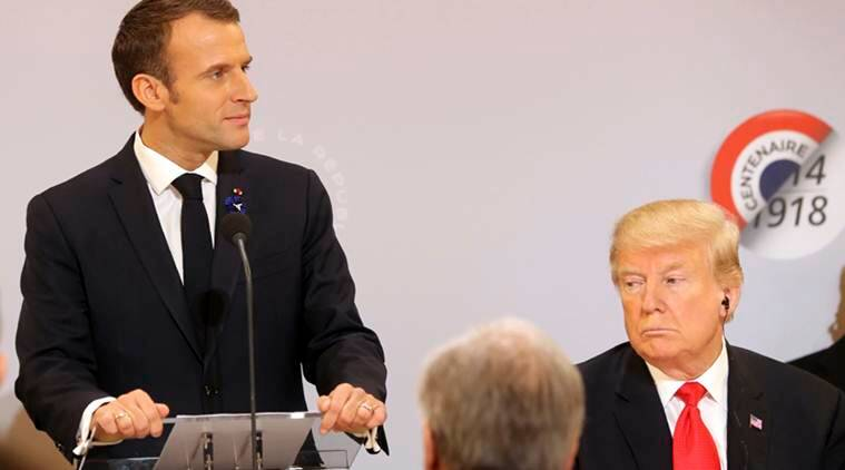 French President Emmanuel Macron delivers a speech while President Donald Trump looks on before a lunch at the Elysee Palace in Paris