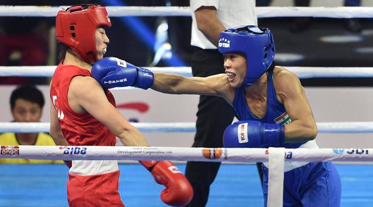 Mary Kom throws a punch at her opponent