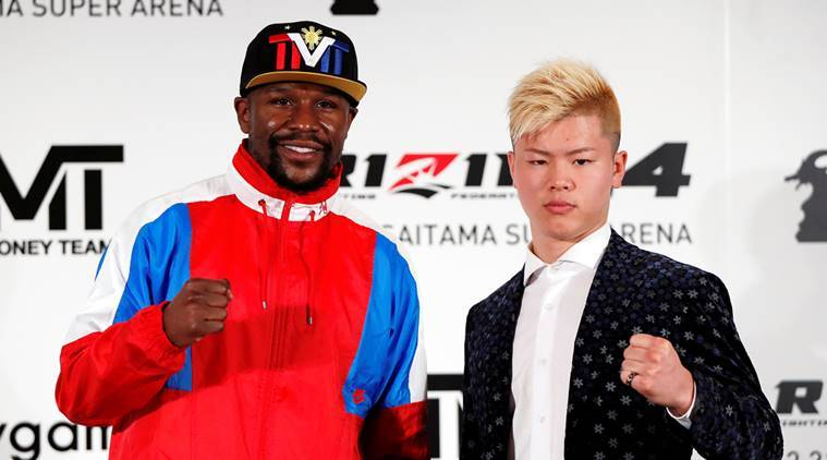 Undefeated boxer Floyd Mayweather Jr. of the U.S. poses for a photograph with his opponent Tenshin Nasukawa during a news conference to announce he is joining Japanese Mixed Martial Arts promotional company Rizin Fighting Federation, in Tokyo, Japan