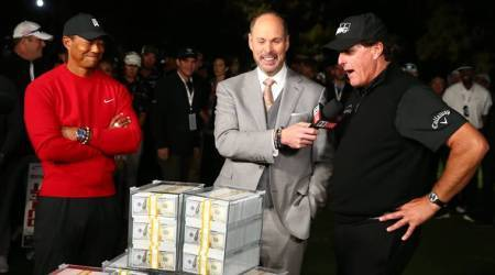 Phil Mickelson (right) reacts after the winner's belt didn't fit as Tiger Woods (left) looks on after The Match: Tiger vs Phil golf match at Shadow Creek Golf Course.