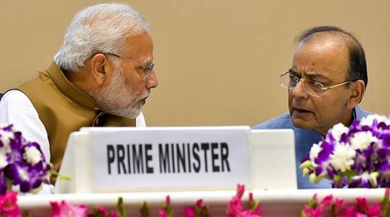 Prime Minister Narendra Modi talks with Finance Minister Arun Jaitley at the function to launch the MSME Support and Outreach Programme, in New Delhi, on Friday. (PTI)