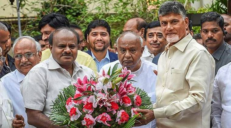 Andhra Pradesh Chief Minister N Chandrababu Naidu (R) greets Karnataka Chief Minister HD Kumaraswamy (L) and former prime minister HD Devegowda (C) before a meeting in Bengaluru on Thursday. (PTI)