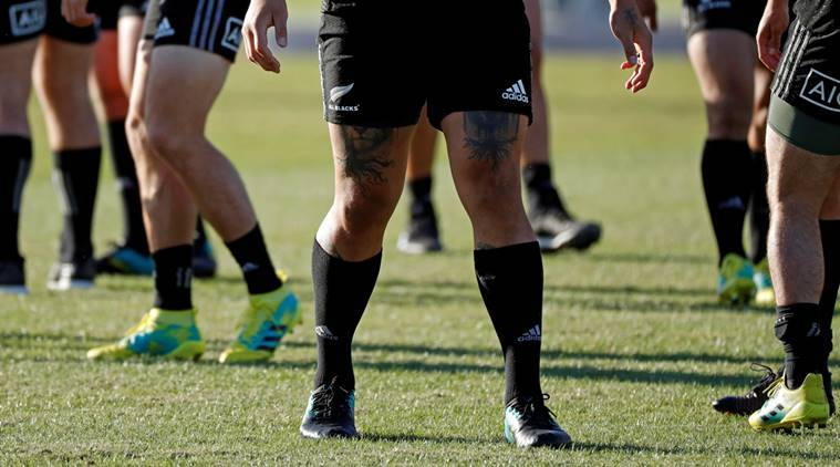 The tattooed limbs of a New Zealand's All Blacks player are seen during their training session in Urayasu, east of Tokyo, Japan