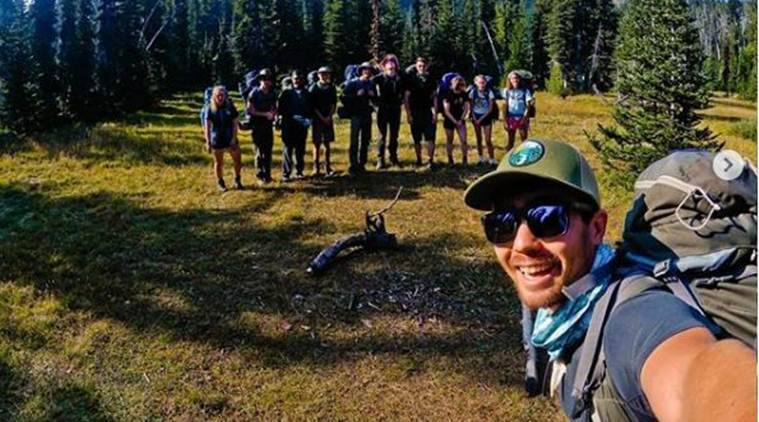 Chau with a group of students around Mount Adams. (Instagram/johnachau)