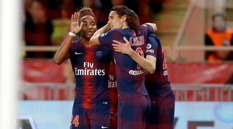 PSG's Edinson Cavani, center, celebrates with teammates after scoring during the French League One soccer match between AS Monaco and Paris Saint-Germain at Stade Louis II in Monaco