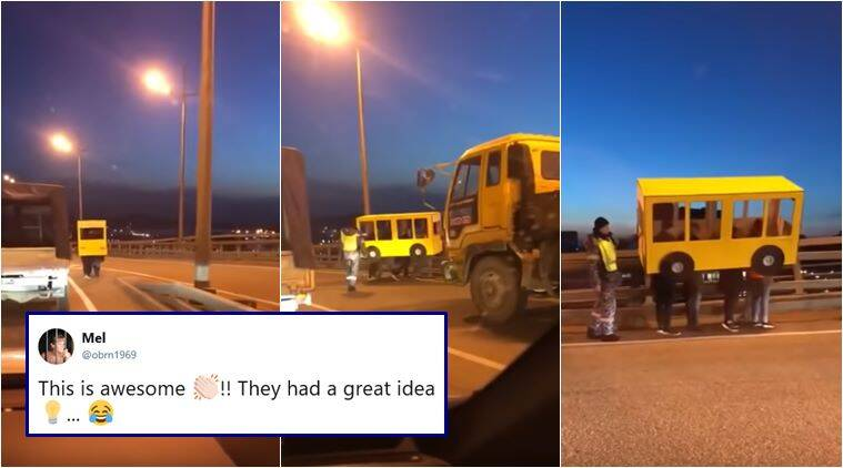 men disguise as bus, russian men dress as bus, men dress as bus to cross bridge, russia, funny videos, viral videos, trending news, viral news, weird news, indian express