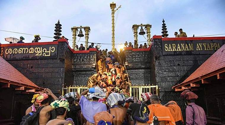 Devotees enter the Sabarimala temple as it opens amid tight security. (PTI)
