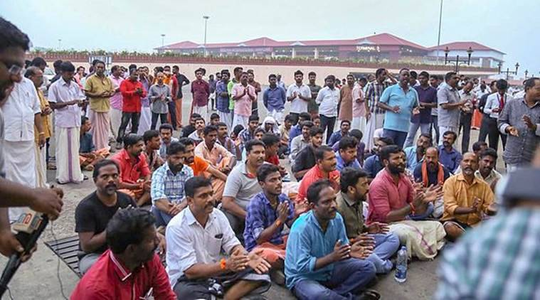 Protesters block the arrival gate of the domestic terminal after Trupti Desai arrived at the airport. (PTI)