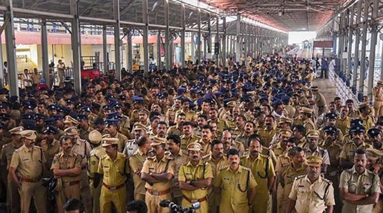 Police stand guard after Trupti Desai arrived at the Cochin International Airport to visit the Sabarimala temple. (PTI)