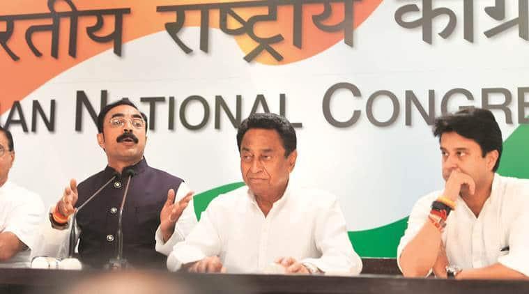 Sanjay Singh Masani with Congress leaders Kamal Nath and Jyotiraditya Scindia in New Delhi on Saturday. (PTI)