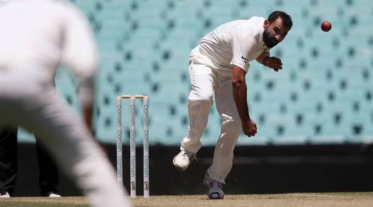 Mohammed Shami, right, bowls a ball that will take a wicket during their tour cricket match against Cricket Australia XI in Sydney