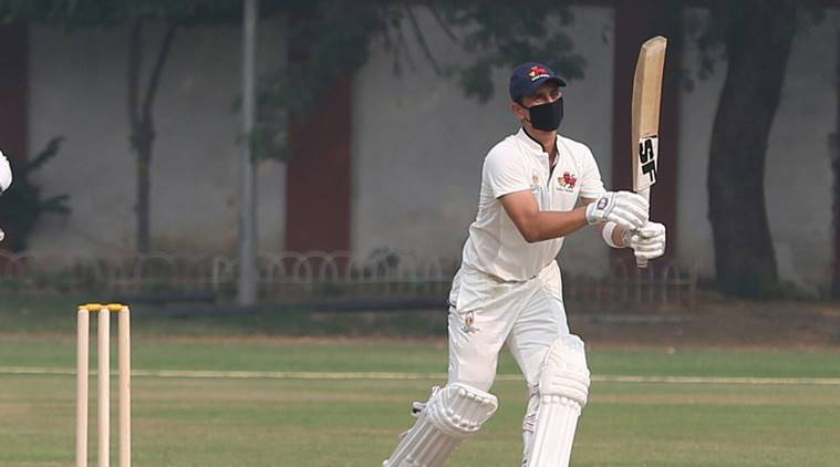 Siddhesh Lad plays with a facemask in the Ranji Trophy