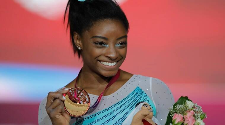 Doha: Gold medallist and four-times All-Around world champion Simone Biles of the U.S., poses on the podium after the Women's All-Around Final of the Gymnastics World Chamionships at the Aspire Dome in Doha, Qatar, Thursday, Nov. 1, 2018. AP/PTI Photo(AP11_1_2018_000273B)