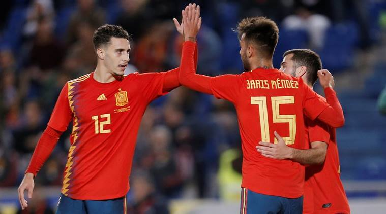 Spain's Brais Mendez celebrates scoring their first goal with Mario Hermoso and Jose Gaya