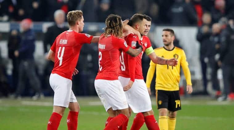 Switzerland's Haris Seferovic celebrates scoring their third goal against Belgium in the UEFA Nations League with Granit Xhaka and team mates