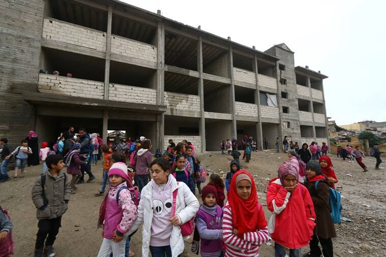 With little aid, Syria's war-torn Raqqa struggles to revive schools